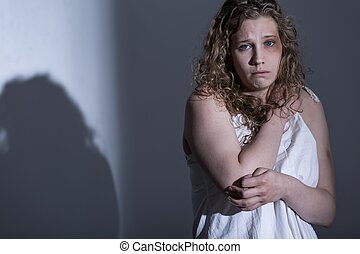 Victim of sexual abuse on gray background