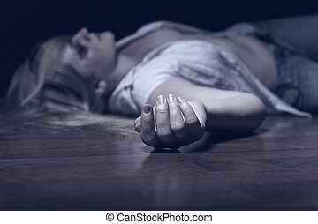 Victim - The dead woman's body. Focus on hand