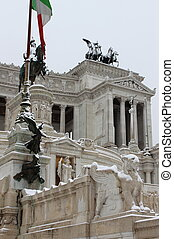Victor Emmanuel II monument under snow in Rome, Italy