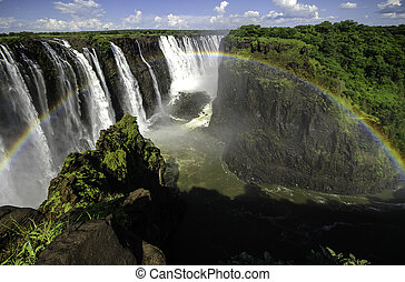Victoria Falls - The Victoria Falls with rainbow in...