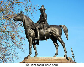 Victorian bronze equestrian monument statue of the Duke of Wellington on his horse Copenhagen stands at Hyde Park Corner London England UK. It was sculpted by Joseph Boehm and was unveiled in 1888 stock photo