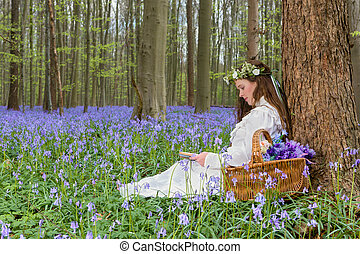 Victorian girl in bluebells forest - Victorian woman in...