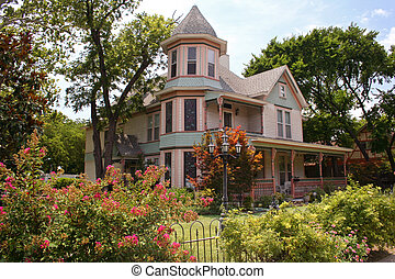Victorian House with fence and plants, Waxahachie TX