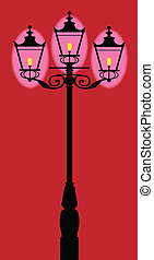 A typical old London gaslight with three flames.
