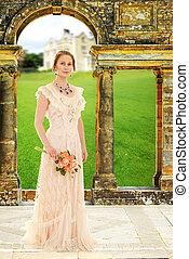 victorian woman in garden by arch