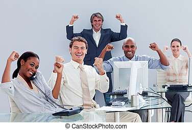 Victorious business team celebrating a success in the office