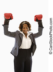 Victorious businesswoman. - Businesswoman wearing boxing...