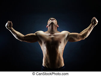 Victorious - Handsome young man with his hands raised up...