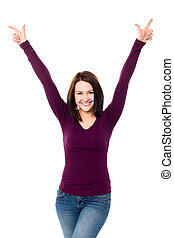 Victorious young woman celebrating her success - Pretty...