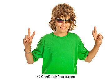 Victory gesturing teen boy - Teen boy with sunglasses...