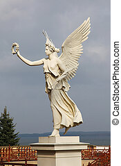 Statue of an angel holding a laurel crown at Schwerin Castle in Schwerin, Mecklenburg-Vorpommern, Germany. This statue was created before 1893, no property release is required.