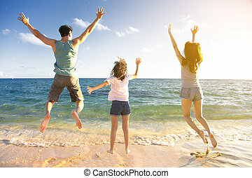vidám család, ugrás, a parton