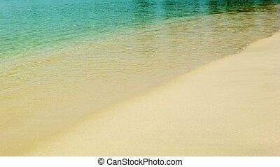 Calm tropical sea and a sandy beach