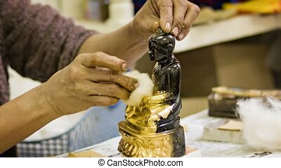 Gilded statues of Buddha in the workshop - Video 1080p -...