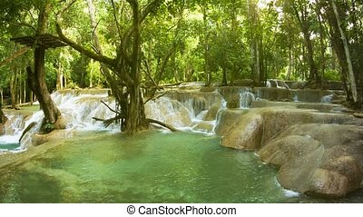 Kouang Si Waterfall, Laos, Luang Prabang. Water flowing in the woods