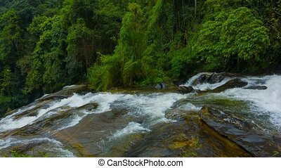 Panorama of waterfalls in the rainforest. Thailand
