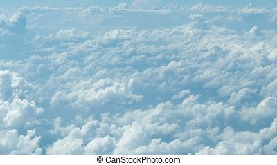 Video 1080p - Sea of clouds. The view from the window of a passenger airliner