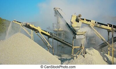 Small factory for the production of gravel for road construction. Stone crusher in Myanmar