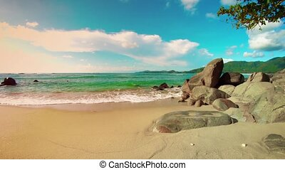 Tropical beach without people. Rocks and yellow sand. Thailand, Phuket