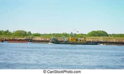 Tug Boat floats on the river past the dredger - Video 1080p...