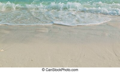 Waves on a sandy beach. Warm tropical sea in Thailand