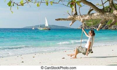 Woman on tropical sea shore. Similan Islands, Thailand