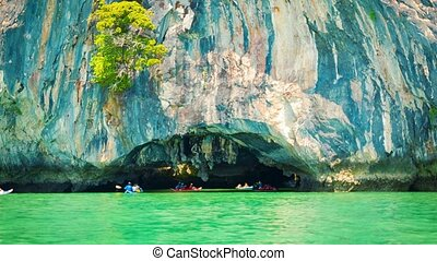 Canoeing near the limestone cliffs. Thailand, Phang Nga -...