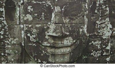 Huge stone face on the wall. Bayon, Angkor, Cambodia - Video...