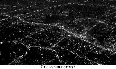 Night lights of the city. View from the airplane window