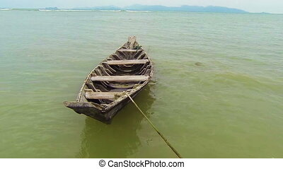 Old wooden simple fisherman boat
