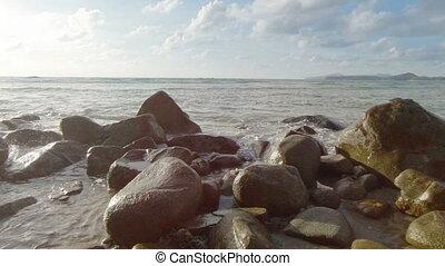 Sea surf and large rocks