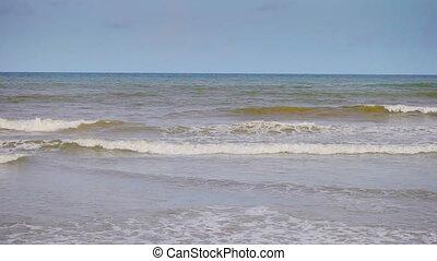 Surf across the sandy beach