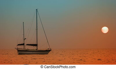 Yacht at anchor in the bay. Sunset on the tropical ocean