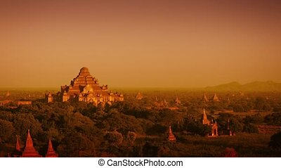 Video 3840x2160 - Landscape in Bagan, Myanmar, with the spires of ancient, Buddhist temple structures at sunset