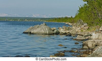 Northern russian landscape - Imandra lake with rocks on the shore