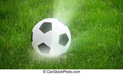 Soccer ball spinning on the field with rays of light