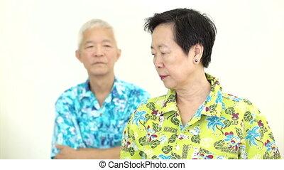 Asian senior couple fighting