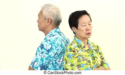 Asian senior couple fighting