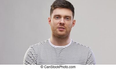 young man in striped t-shirt talking - video blogging, ...