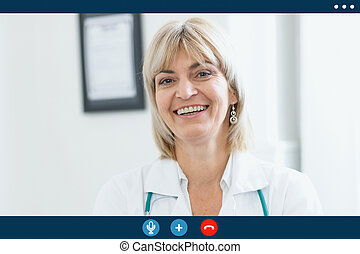 Video call screen of smiling middle age doctor