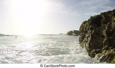 Video camera on the water surface filmed the waves beat against the rocks.