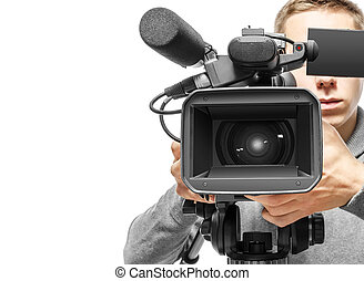 Video camera operator working with his professional...