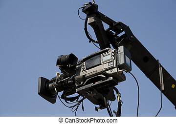 video camera - TV camera on the crane and with blue sky in...