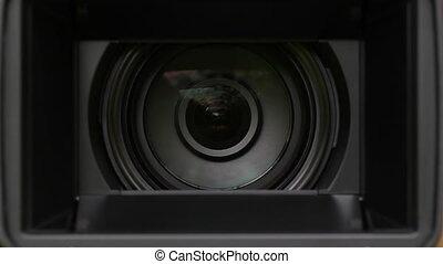 Video camera zoom.