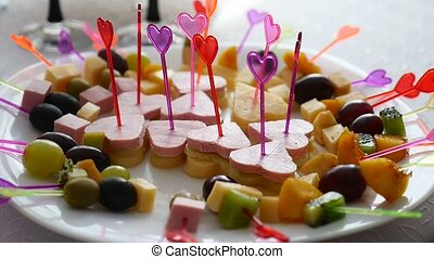 video canapes with olives in a bowl on a table - video...