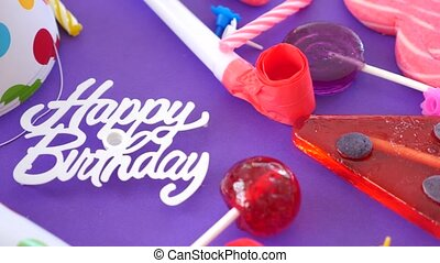 video card birthday greeting. inscription, candies, cake candles and holiday caps. 4k.