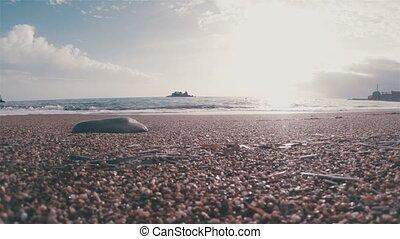 surf wave on a pebble beach