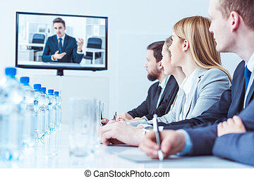 Video conference with businesspeople