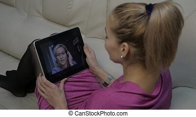 video conferencing with tutor. Young woman having online...