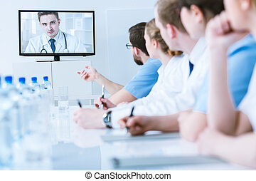 Video consultation with medic - Medics in uniforms during...